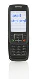 Mobile phone with message. Close-up of slide phone with INSERT SIM CARD message, image on the screen has a clearly visible net simulating display pixels Royalty Free Stock Photography