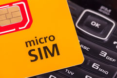 Mobile phone with micro sim card Stock Images