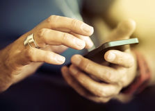 Mobile phone. Middle-aged man using a smart mobile phone stock images