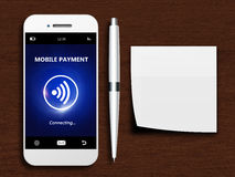Mobile phone with mobile payment, pen and empty note Royalty Free Stock Images
