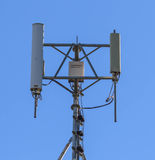 Mobile Phone Mobile Tower. Mobile Telephone pole isolate on light blue sky Stock Image