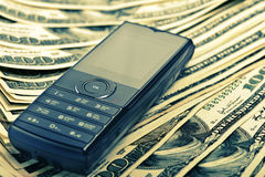 Mobile phone on the money Stock Images