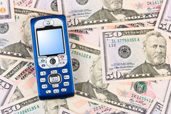 Mobile phone on money background Stock Image