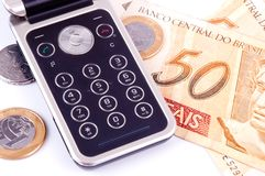 Mobile phone and money from Brazil Stock Photography