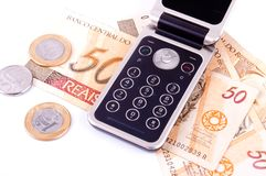 Mobile phone and money from Brazil Stock Photo