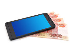 Mobile phone and money Stock Photo