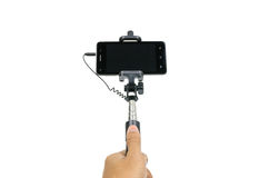 Mobile phone and monopod Royalty Free Stock Photography