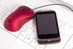 Mobile phone and mouse Stock Photo