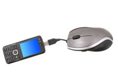 Mobile phone and Mouse. Isolated ergonomic mouse and a black mobile phone with globe on the screen shot over white background Stock Photo