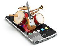 Mobile phone and musical instruments. Guitar, drums and trumpet. Royalty Free Stock Images
