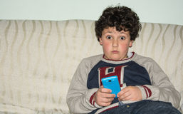 The mobile phone,  new babysitter. Royalty Free Stock Photography
