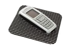 Mobile phone on non slip mat Stock Image