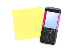 Mobile phone and note paper Royalty Free Stock Image