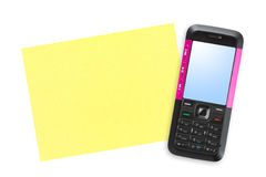 Mobile phone and note paper Stock Image
