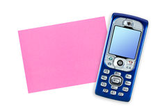 Mobile phone and note paper Royalty Free Stock Photography