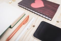 Mobile phone, notebook, pen royalty free stock photography