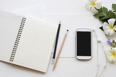 Mobile phone ,notebook of student writing note for study. Mobile phone ,notebook ,pencil of student writing note for study decoration flat lay style on stock photography
