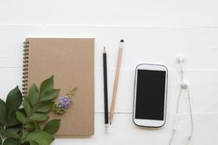 Mobile phone ,notebook of student writing note for study. Mobile phone ,notebook ,pencil of student writing note for study decoration flat lay style on royalty free stock photos