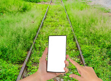Mobile phone and old railway Royalty Free Stock Image