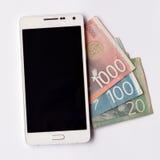 Mobile phone over Serbian dinar banknotes Stock Photos