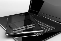 Mobile phone with pad and laptop. On white tablet Royalty Free Stock Photo