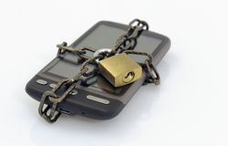 Mobile phone, padlock and chain Stock Photos