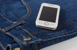 Mobile Phone on Blue Jeans Royalty Free Stock Images