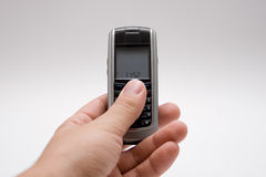 Mobile phone in palm, isolated Royalty Free Stock Photo
