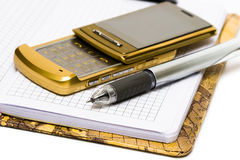 Mobile phone with pen Stock Image