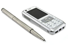 mobile phone and pen Stock Images