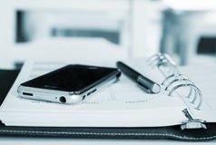 Mobile phone and pen Royalty Free Stock Images