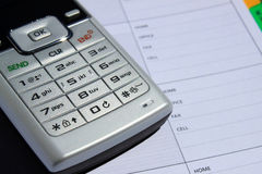 Mobile phone on phone book Royalty Free Stock Photos