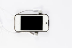 Mobile phone with phone headsets Stock Image