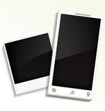 Mobile phone and photo frame Royalty Free Stock Image