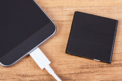 Mobile phone, plug of charger and telephone battery, smartphone charging Royalty Free Stock Image