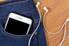 Mobile phone in pocket Royalty Free Stock Images