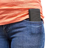 Mobile phone in a pocket of blue jeans. Isolated on white background Stock Photos