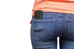 Mobile phone in a pocket of blue jeans. Isolated on white background Stock Image