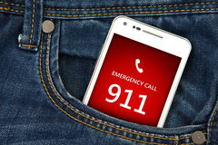 Mobile phone in pocket with emergency number 911. focus on scree Stock Photo