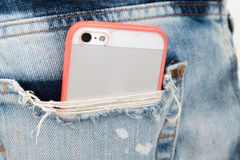 Mobile phone in pocket jean Royalty Free Stock Images