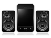 Mobile phone with portable speakers Royalty Free Stock Images