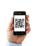 Mobile phone with QR code on the screen Stock Photography