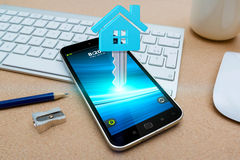 Mobile phone with real estate application Royalty Free Stock Images