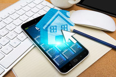 Mobile phone with real estate application Royalty Free Stock Image