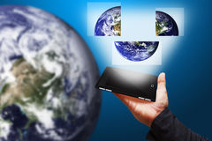 Mobile Phone and rebuild the Earth jigsaw Stock Photo