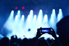 Mobile phone recording live concert Royalty Free Stock Photo