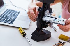The mobile phone repair in workshop. Mobile phone repair in workshop royalty free stock photo