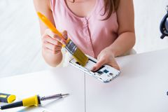 The mobile phone repair in workshop. Mobile phone repair in workshop royalty free stock photography