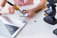 The mobile phone repair in workshop. Mobile phone repair in workshop stock image
