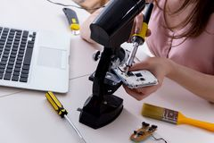 The mobile phone repair in workshop. Mobile phone repair in workshop royalty free stock images